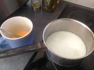 Pour the hot milk into the paste! Then stir. THEN return to pan.